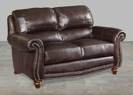 brown leather loveseat with nailheads