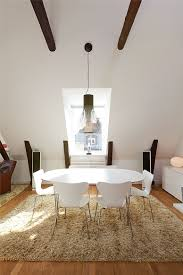 elegant modern dining room design with white plastic oval dining table and chairs plus hanging