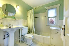 The light green and white wall and vanities combine to create a cool color  combination that
