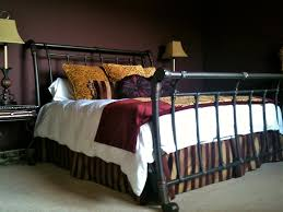 black brushed rod iron portable beds frame on light gray pile carpet as well as iron bedroom bedroom endearing rod iron