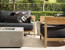 rh s balmain outdoor collection in teak wood is modern in its material use construction and color but it sports a very satisfying back curve that also