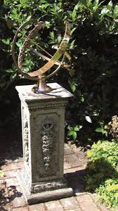 large brass armillary garden statue
