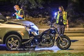 1 in custody after deadly motorcycle crash