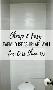 photo of faux shiplap behind toilet in small bathroom with text overlay that says and