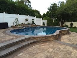 radiant 16x27 semiinground freeform with inside step and water feature partial inground pool a45