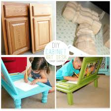 diy cabinet art desk cabinet door into art desk tutorial this is an awesome idea to create a little work area for little ones