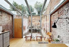 modern sunroom. Modern Industrial Sunroom With Lovely Brick Walls And A Glass Ceiling E