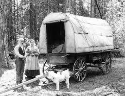 black and white covered wagon. a man and woman with covered wagon, prospect, oregon. black white wagon