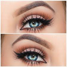 rose gold eye makeup with winged liner