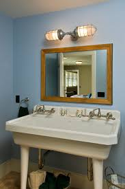 2011 showcase hillside retreat mountain style kids bathroom photo in other with a trough sink and bathroom mirror and lighting ideas