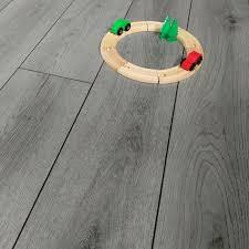 prestige plus 12mm silver oak plank ac4 laminate flooring main shot lifestyle image jpg
