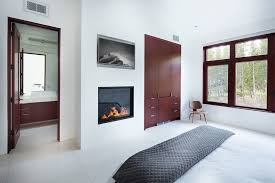 painted brick interior bedroom contemporary with fireplace