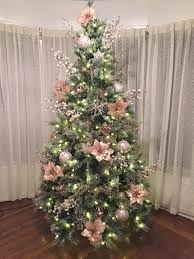 Light Pink And White Christmas Tree Pink Poinsettias Decorate This Christmas Tree White Lights