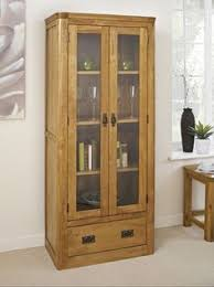 knightsbridge oak glass display cabinet with drawer is a high quality oak furniture range constructed from quality solid oak with classic finger joints on aston solid oak wall mirror