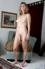 Mature MILF with Coin Slot Pussy Wearing Pink Lingerie Image.