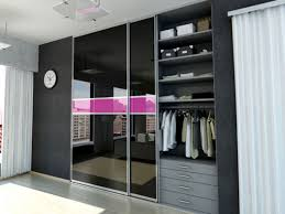 sliding glass closet door in black and pink color horizontal line havinggrey aluminium frame