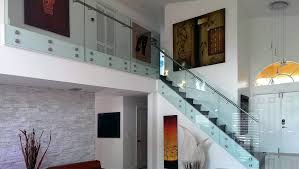 glass standoff railing system with stainless steel elements