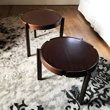 a pair of round coffee tables in mahogany 1960