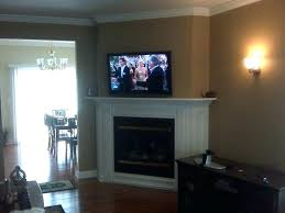 tv over fireplace where to put components mounting above fireplace how to hide cords on wall