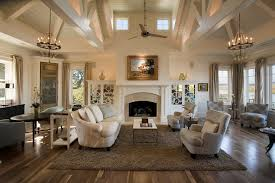 chandelier ceiling fan living room beach with art above fireplace beige