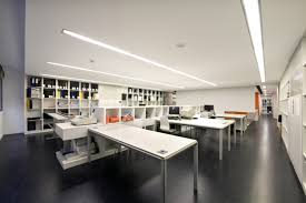 office design interior. interior office and workspace simply white table with storage divider wall bookshelves in black studio design modern