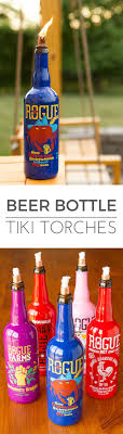Beer Bottle Tiki Torches -- using colorful Rogue craft beer bottles makes  for a fresh