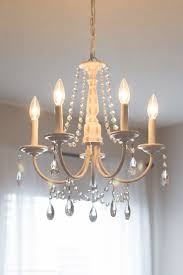 You can make your own DIY crystal chandelier. This site shows you how! #