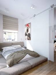 Minimalist Small Bedroom Bedroom Smooth Grey Fur Rug On Wooden Floor Mixed With White