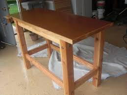 a wooden workbench with a vise