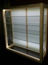 wooden glass display show cases and cabinets with glass shelves sliding side doors