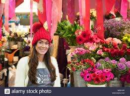 cardiff market cardiff wales uk 8th february 2018 kelly bridgeman 31 smiles proudly infront of her stall secret garden florist in cardiff marke