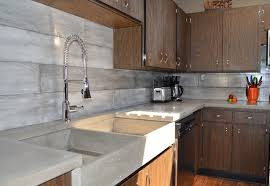 plank form concrete backsplash a farmer s sink built in draining board midcentury