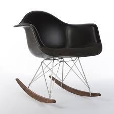black upholstered two tone vinyl fabric black eames arm s on rar base