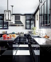 at a manhattan apartment designed by steven gambrel pendant lights by gambrel for the urban electric co hang in the kitchen which features walls sheathed