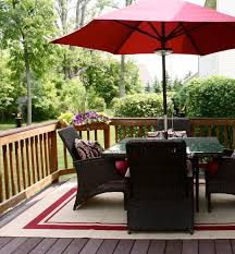 wood deck with wicker furniture set and outdoor rugs ikea