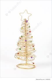 Holidays: A small golden wire Christmas tree