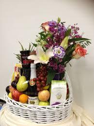flowers and goos send a custom designed basket of fresh flowers seasonal fruits gourmet