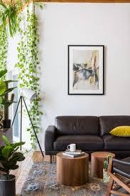 modern room nesting tables houseplants les aventurieres decoration salon walnut veneer eames chairs modern apartments apartment goals