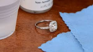 enement ring next to jewelry cleaner