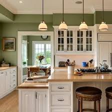 Captivating A Color Thatu0027s Easy To Live With, Moss Green Evokes The Great Outdoors.  White Cabinets And Light Butcher Block Counters Are A Pleasing Combination  With ...