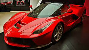 Beautifully accented with carbon fiber trim and the factory two tone roof. The Sexiest Laferrari Ever Dark Red Ferrari Laferrari At Spanish Bay Mon Ferrari Laferrari Running Shoes For Men Ferrari