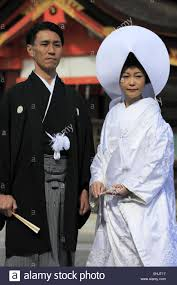 a japanese couple in traditional japanese wedding kimono posing Wedding Kimono Male a japanese couple in traditional japanese wedding kimono posing for camera in yasaka jinjia shrine, gion, kyoto, japan wedding kimono for sale