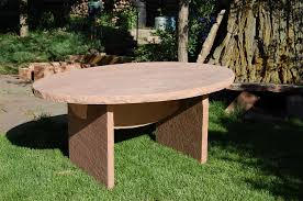 elliptical sandstone dining table for a more formal outdoor