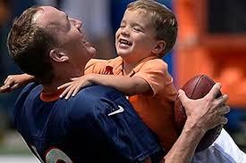 peyton manning kids. Peyton Manning Tackled By His Kids Broncos Training Camp T