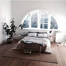 I don't like the minimalism here but like the window - Minimalist boho  bedroom