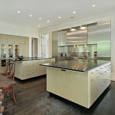 Thin black paper composite countertops on light pine wood cabinetry. What  this kitchen lacks in