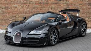 By winning the targa florio for five years straight. 2013 Bugatti Veyron Grand Sport Vitesse Full Black Carbon Walkaround Interior Youtube