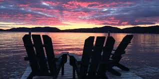Adirondack chairs on beach sunset Masterfile Adirondack Experience Sunset Beach Cottages Adirondack Experience