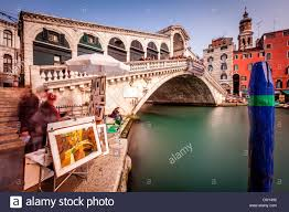 local artist ing paintings by the rialto bridge venice italy