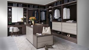 this london walk in wardrobe and dressing room by neatsmith features an island and a california closets